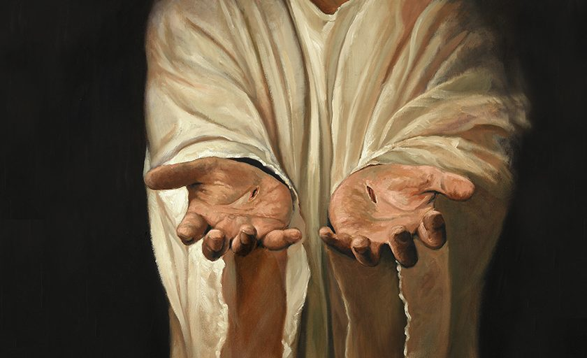 Jesus' nail-scarred hands outstretched